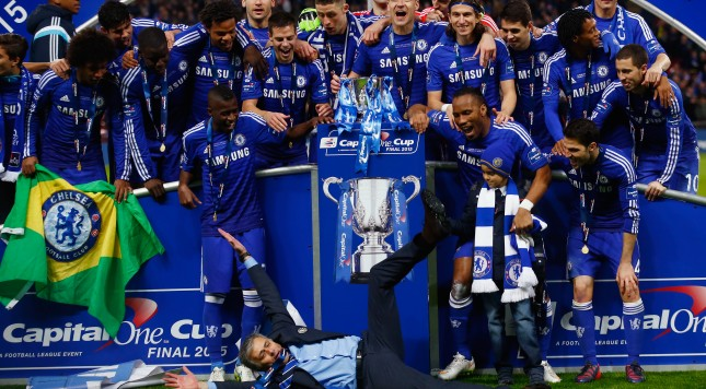 LONDON, ENGLAND - MARCH 01:  Manager Jose Mourinho of Chelsea lies on the pitch as Chelsea celebrate with the trophy during the Capital One Cup Final match between Chelsea and Tottenham Hotspur at Wembley Stadium on March 1, 2015 in London, England.  (Photo by Clive Rose/Getty Images)