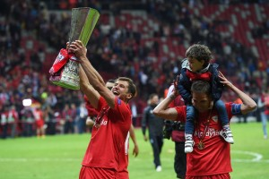Sevilla FC's Grzegorz Krychowiak lifts the Europa League trophy