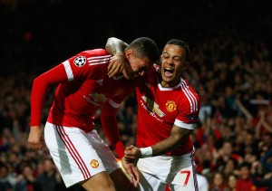 MANCHESTER, ENGLAND - SEPTEMBER 30:  Chris Smalling of Manchester United (L) celebrates with team mate Memphis Depay as he scores their second goal during the UEFA Champions League Group B match between Manchester United FC and VfL Wolfsburg at Old Trafford on September 30, 2015 in Manchester, United Kingdom.  (Photo by Dean Mouhtaropoulos/Getty Images)