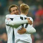 MUNICH, GERMANY - MARCH 22:  Fabian Johnson of Moenchengladbach celebrates with his team mate Oskar Wendt after the Bundesliga match between FC Bayern Muenchen and Borussia Moenchengladbach at Allianz Arena on March 22, 2015 in Munich, Germany.  (Photo by Alexander Hassenstein/Getty Images For MAN)