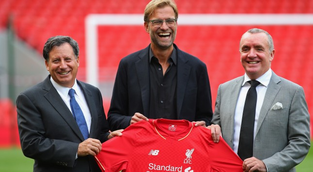 LIVERPOOL, ENGLAND - OCTOBER 09:  Jurgen Klopp at Anfield is unveiled as the new manager of Liverpool FC as he stands alongside Tom Werner (l) the chairman and Ian Ayre (r) the chief executive during a photocall at Anfield on October 9, 2015 in Liverpool, England.  (Photo by Alex Livesey/Getty Images)
