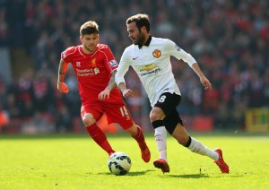 LIVERPOOL, ENGLAND - MARCH 22: Juan Mata of Manchester United is closed down by Alberto Moreno of Liverpool during the Barclays Premier League match between Liverpool and Manchester United at Anfield on March 22, 2015 in Liverpool, England.  (Photo by Alex Livesey/Getty Images)