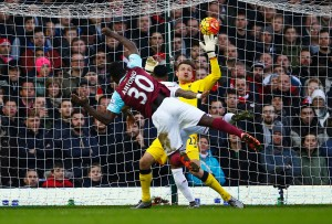 LONDON, ENGLAND - JANUARY 02: Michail Antonio of West Ham United scores his team's first goal during the Barclays Premier League match between West Ham United and Liverpool at Boleyn Ground on January 2, 2016 in London, England.  (Photo by Christopher Lee/Getty Images)
