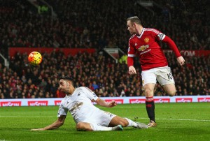 MANCHESTER, ENGLAND - JANUARY 02:  Wayne Rooney of Manchester United scores his team's second goal during the Barclays Premier League match between Manchester United and Swansea City at Old Trafford on January 2, 2016 in Manchester, England.  (Photo by Alex Livesey/Getty Images)