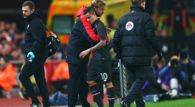 STOKE ON TRENT, ENGLAND - JANUARY 05:  The injured Philippe Coutinho of Liverpool is hugged by Jurgen Klopp the Manager of Liverpool as leaves the pitch due to injury during the Capital One Cup semi final, first leg match between Stoke City and Liverpool at the Britannia Stadium on January 5, 2016 in Stoke on Trent, England.  (Photo by Clive Mason/Getty Images)