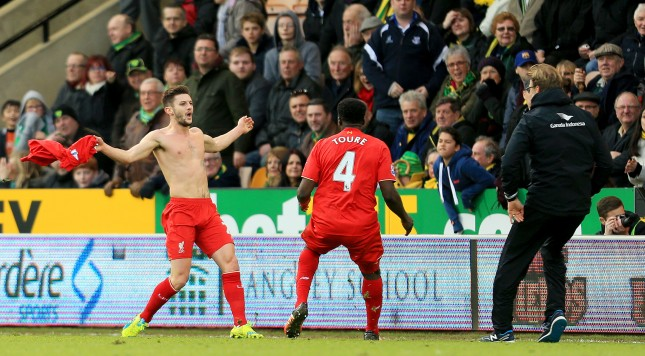 NORWICH, ENGLAND - JANUARY 23: Adam Lallana (L) of Liverpool ceelbrates scoring his team's fifth goal with his manager Jurgen Klopp (R) and team mate Kolo Toure (C) during the Barclays Premier League match between Norwich City and Liverpool at Carrow Road on January 23, 2016 in Norwich, England.  (Photo by Stephen Pond/Getty Images)