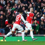 LONDON, ENGLAND - JANUARY 30: Calum Chambers (R) of Arsenal celebrates scoring his team's first goal with his team mate Alex Oxlade-Chamberlain (L) during the Emirates FA Cup Fourth Round match between Arsenal and Burnley at Emirates Stadium on January 30, 2016 in London, England.  (Photo by Paul Gilham/Getty Images)