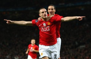 MANCHESTER, UNITED KINGDOM - MARCH 11:  Nemanja Vidic of Manchester United celebrates scoring the opening goal with team mate Rio Ferdinand (R) during the UEFA Champions League Round of Sixteen, Second Leg match between Manchester United and Inter Milan at Old Trafford on March 11, 2009 in Manchester, England.  (Photo by Laurence Griffiths/Getty Images)