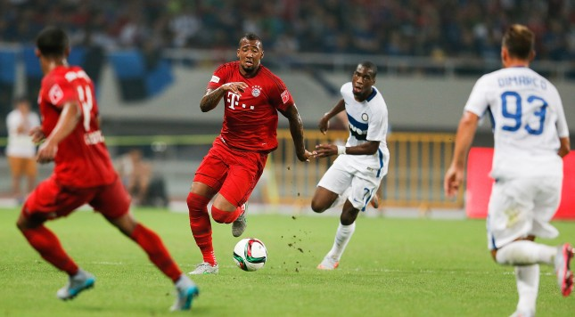 SHANGHAI, CHINA - JULY 21:  Jerome Boateng (2nd-L) of FC Internazionale challenges Geoffry Kongdogbia and Federico Dimarco of FC Bayern Muenchen during the international friendly match between FC Bayern Muenchen and Inter Milan of the Audi Football Summit 2015 at Shanghai Stadium on July 21, 2015 in Shanghai, China.  (Photo by Lintao Zhang/Getty Images)