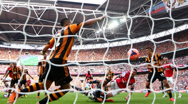 LONDON, ENGLAND - MAY 17:  Laurent Koscielny of Arsenal shoots past goalkeeper Allan McGregor of Hull City as he scores their second goal during the FA Cup with Budweiser Final match between Arsenal and Hull City at Wembley Stadium on May 17, 2014 in London, England.  (Photo by Clive Mason/Getty Images)