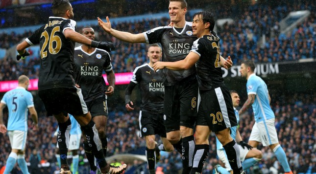 MANCHESTER, ENGLAND - FEBRUARY 06:  Robert Huth (3rd L) of Leicester City celebrates scoring his team's first goal with his team mate Shinji Okazaki (2nd R) and Riyad Mahrez (1st L) during the Barclays Premier League match between Manchester City and Leicester City at the Etihad Stadium on February 6, 2016 in Manchester, England.  (Photo by Alex Livesey/Getty Images)