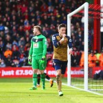 BOURNEMOUTH, ENGLAND - FEBRUARY 07:  Goalkeeper Artur Boruc of Bournemouth looks dejected as Mesut Ozil of Arsenal celebrates as he scores their first goal during the Barclays Premier League match between A.F.C. Bournemouth and Arsenal at the Vitality Stadium on February 7, 2016 in Bournemouth, England.  (Photo by Matthew Lewis/Getty Images)