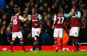LONDON, ENGLAND - FEBRUARY 09:  Michail Antonio of West Ham United (30) celebrates with Mark Noble (16), Dimitri Payet (27) and Cheikhou Kouyate (8) as he scores their first goal during the Emirates FA Cup Fourth Round Replay match between West Ham United and Liverpool at Boleyn Ground on February 9, 2016 in London, England.  (Photo by Clive Rose/Getty Images)