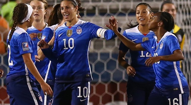 FRISCO, TX - FEBRUARY 15:  Carli Lloyd #10 of USA celebrates her goal against Puerto Rico during CONCACAF Women's Olympic Qualifying at Toyota Stadium on February 15, 2016 in Frisco, Texas.  (Photo by Ronald Martinez/Getty Images)