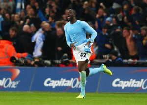 LONDON, ENGLAND - FEBRUARY 28:  Yaya Toure of Manchester City celebrates as he scores the winning penalty to win the shoot out during the Capital One Cup Final match between Liverpool and Manchester City at Wembley Stadium on February 28, 2016 in London, England.  (Photo by Clive Brunskill/Getty Images)
