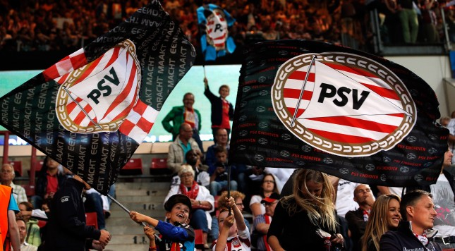 EINDHOVEN, NETHERLANDS - AUGUST 20:  PSV fans show their support during the UEFA Champions League Play-off First Leg match between PSV Eindhoven and AC Milan at PSV Stadion on August 20, 2013 in Eindhoven, Netherlands.  (Photo by Dean Mouhtaropoulos/Getty Images)