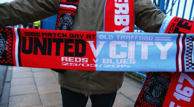 MANCHESTER, ENGLAND - MARCH 25:  A vendor sells match scarves prior to the Barclays Premier League match between Manchester United and Manchester City at Old Trafford on March 25, 2014 in Manchester, England.  (Photo by Alex Livesey/Getty Images)