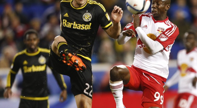 HARRISON, NJ - NOVEMBER 29:  Bradley Wright-Phillips #99 of New York Red Bulls fights for the ball with Gaston Sauro #22 of the Columbus Crew during their match at Red Bull Arena on November 29, 2015 in Harrison, New Jersey.  (Photo by Jeff Zelevansky/Getty Images)