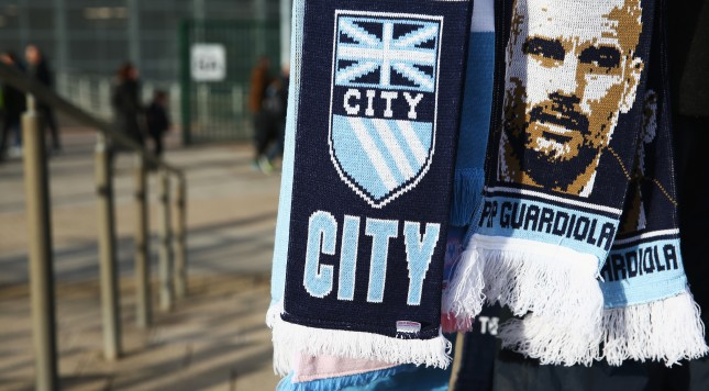 MANCHESTER, ENGLAND - FEBRUARY 14:  A Pep Guardiola scarf is carried outside the ground prior to the Barclays Premier League match between Manchester City and Tottenham Hotspur at Etihad Stadium on February 14, 2016 in Manchester, England.  (Photo by Clive Brunskill/Getty Images)