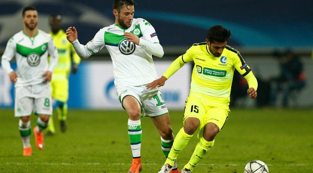 GENT, BELGIUM - FEBRUARY 17:  Kenny Saief of KAA Gent is challenged by Christian Traesch of Wolfsburg during the UEFA Champions League round of 16,  first leg match between KAA Gent and VfL Wolfsburg at Ghelamco Arena on February 17, 2016 in Gent, Belgium.  (Photo by Dean Mouhtaropoulos/Getty Images)