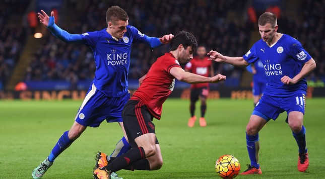 LEICESTER, ENGLAND - MARCH 01:  Claudio Yacob (C) of West Bromwich Albion competes for the ball against Jamie Vardy (L) and Marc Albrighton (R) of Leicester City compete for the ball during the Barclays Premier League match between Leicester City and West Bromwich Albion at The King Power Stadium on March 1, 2016 in Leicester, England.  (Photo by Michael Regan/Getty Images)