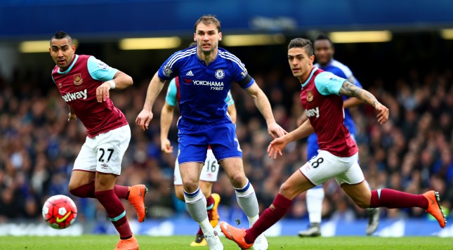 LONDON, ENGLAND - MARCH 19:  Branislav Ivanovic (C) of Chelsea competes for the ball against Dimitri Payet (L) and Manuel Lanzini (R) of West Ham United during the Barclays Premier League match between Chelsea and West Ham United at Stamford Bridge on March 19, 2016 in London, United Kingdom.  (Photo by Paul Gilham/Getty Images)