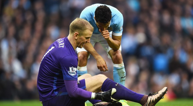 MANCHESTER, ENGLAND - MARCH 20:  Joe Hart of Manchester City is injured as he speaks to Gael Clichy of Manchester City during the Barclays Premier League match between Manchester City and Manchester United at Etihad Stadium on March 20, 2016 in Manchester, United Kingdom.  (Photo by Laurence Griffiths/Getty Images)