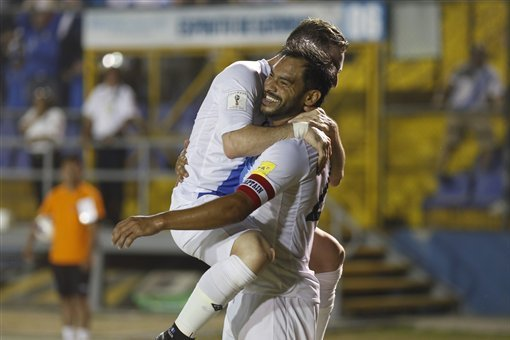 Guatemala's Carlos Ruiz, right, celebrates with a teammate after scoring against the United States during a 2018 Russia World Cup qualifying soccer match at Mateo Flores Stadium in Guatemala City, Friday, March 25, 2016. (AP Photo/ Luis Soto)