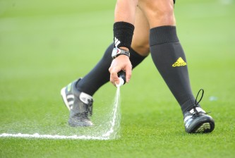 KANSAS CITY, KS - JUNE 25:  A referee sprays a mark on the field prior to a penalty kick during a match between Sporting Kansas City and Vancouver Whitecaps FC on June 25, 2011 at LiveStrong Sporting Park in Kansas City, Kansas. (Photo by G. Newman Lowrance/Getty Images)