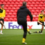 LIVERPOOL, ENGLAND - APRIL 13:  Christian Pulisic of Borussia Dortmund and Eric Durm of Borussia Dortmund stretch during a training session ahead of the UEFA Europa League quarter final between Liverpool and Borussia Dortmund at Anfield on April 13, 2016 in Liverpool, United Kingdom.  (Photo by Clive Brunskill/Getty Images)