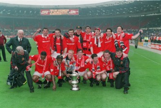 14 MAY 1994:  MANCHESTER UNITED VS CHELSEA IN THE FA CUP FINAL. MANCHESTER UNITED CELEBRATES THEIR WIN WITH THE TROPHY.  MANCHESTER UNITED DEFEATED CHELSEA 4-0 TO BECOME ONLY THE SIXTH CLUB IN ENGLISH HISTORY TO CATURE BOTH THE FA CUP AND LEAGUE TITLE INTHE SAME SEASON. Mandatory Credit: David Cannon/ALLSPORT