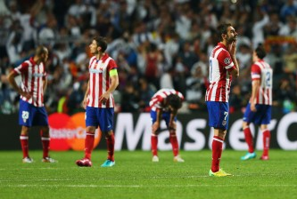LISBON, PORTUGAL - MAY 24:  A dejected Adrian Lopez of Club Atletico de Madrid looks on after defeat during the UEFA Champions League Final between Real Madrid and Atletico de Madrid at Estadio da Luz on May 24, 2014 in Lisbon, Portugal.  (Photo by Alex Livesey/Getty Images)