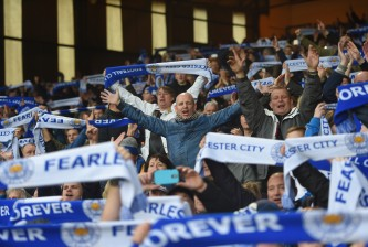 LONDON, ENGLAND - MARCH 19:  Leicester City supporters celebrate their team's win after the Barclays Premier League match between Crystal Palace and Leicester City at Selhurst Park on March 19, 2016 in London, United Kingdom.  (Photo by Michael Regan/Getty Images)