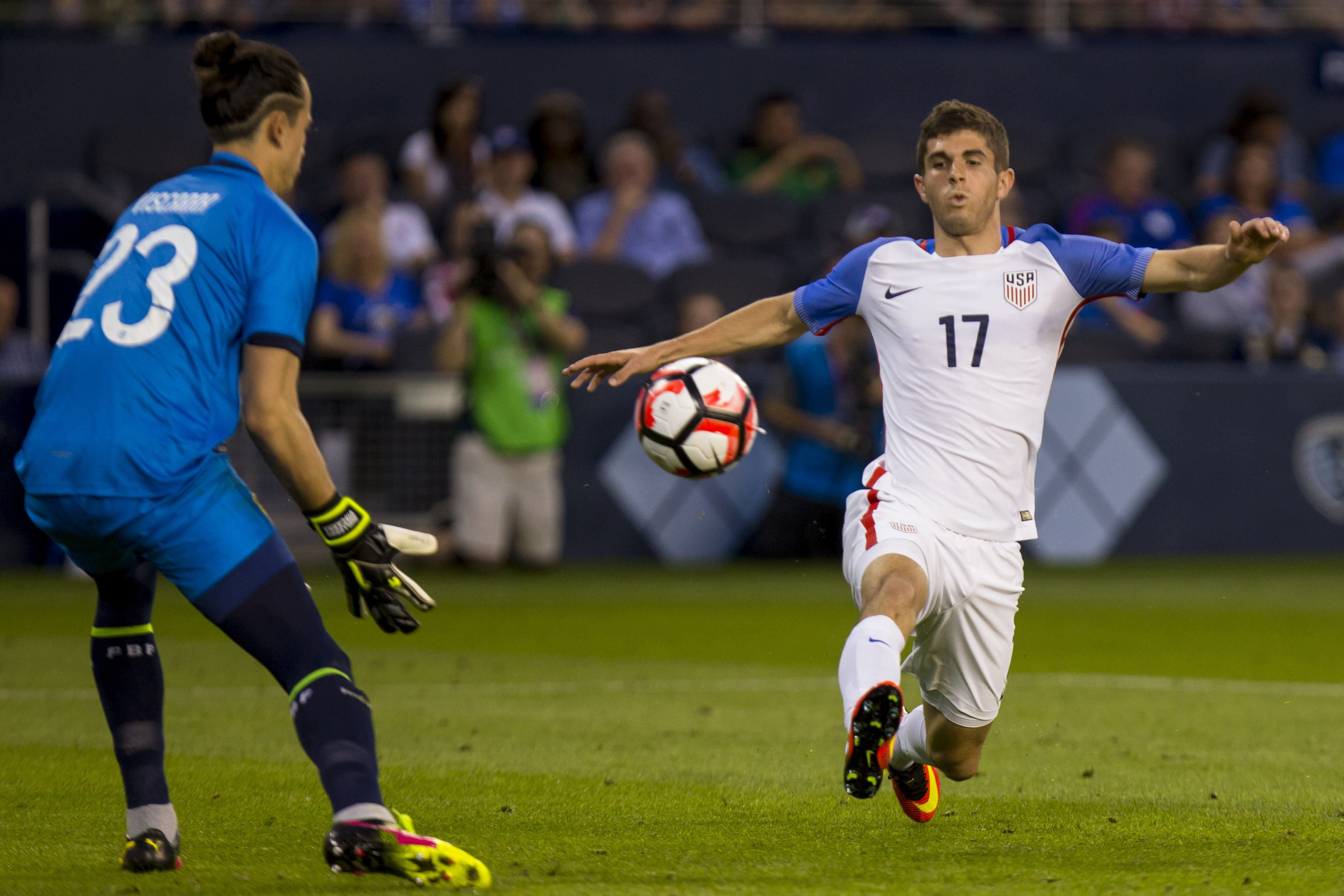 KANSAS CITY, KS - MAY 28: Christian Pulisic #17 of USA attempts to chip a pass past Guillermo Viscarra #23 of Bolivia late in the second half of an international friendly match between Bolivia and the United States on May 28, 2016 at Children's Mercy Park in Kansas City, Kansas.  (Photo by Kyle Rivas/Getty Images)