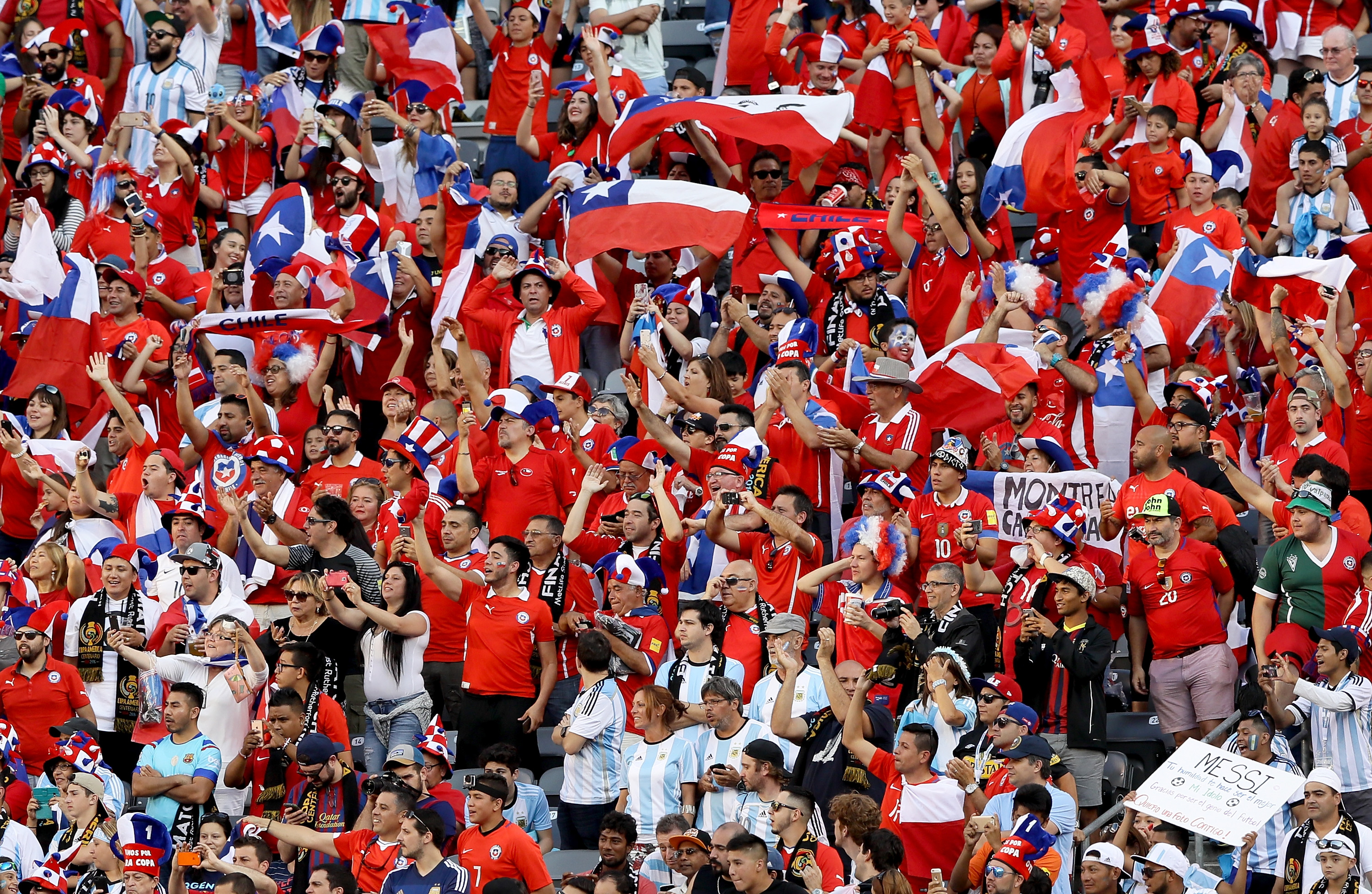 EAST RUTHERFORD, NJ - JUNE 26:  Chile fans celebrate as their team heads out for warm ups before the Copa America Centenario Championship match at MetLife Stadium on June 26, 2016 in East Rutherford, New Jersey.  (Photo by Elsa/Getty Images)
