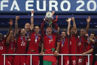 PARIS, FRANCE - JULY 10:  Cristiano Ronaldo of Portugal (c) lifts the Henri Delaunay trophy after his side win 1-0 against France during the UEFA EURO 2016 Final match between Portugal and France at Stade de France on July 10, 2016 in Paris, France.  (Photo by Lars Baron/Getty Images)
