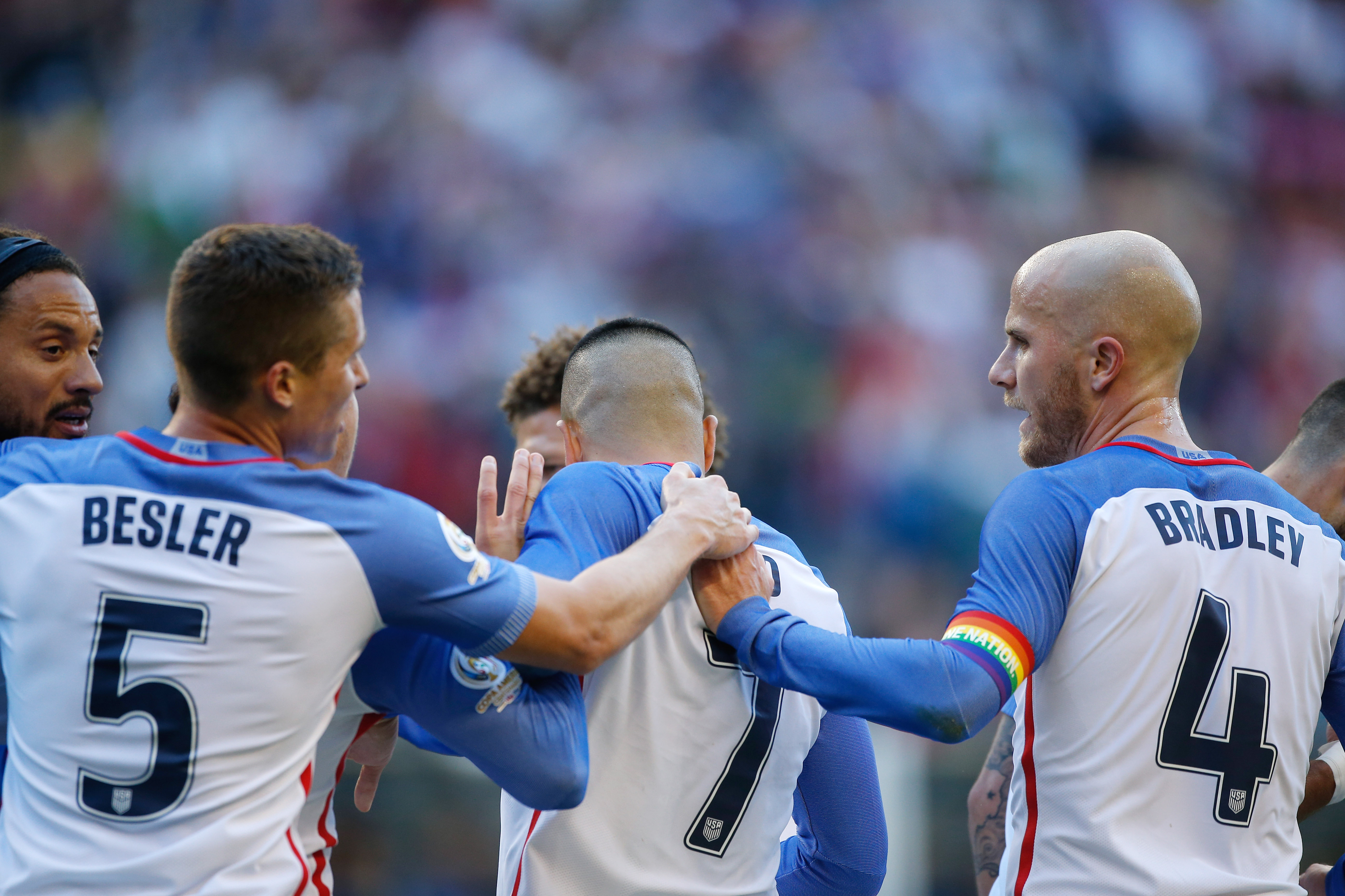 SEATTLE, WA - JUNE 16:  Michael Bradley #4 of the United States celebrates with teammates after Clint Dempsey (not pictured) scored a goal against Ecuador during the 2016 Quarterfinal - Copa America Centenario match at CenturyLink Field on June 16, 2016 in Seattle, Washington. Bradley wore a rainbow colored armband in remembrance of the Orlando shooting victims.  (Photo by Otto Greule Jr/Getty Images)