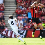 BOURNEMOUTH, ENGLAND - AUGUST 14: Juan Mata of Manchester United turns away after scoring the opening goal as Simon Francis of AFC Bournemouth reacts during the Premier League match between AFC Bournemouth and Manchester United at Vitality Stadium on August 14, 2016 in Bournemouth, England.  (Photo by Stu Forster/Getty Images)