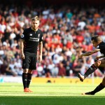 LONDON, ENGLAND - AUGUST 14: Philippe Coutinho of Liverpool scores with a free kick during the Premier League match between Arsenal and Liverpool at Emirates Stadium on August 14, 2016 in London, England.  (Photo by Mike Hewitt/Getty Images)