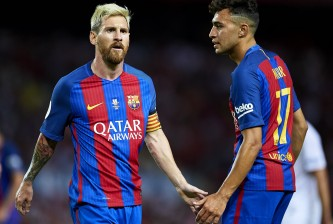 SEVILLE, SPAIN - AUGUST 14:  Lionel Messi of FC Barcelona (L) shake hands with his team mate Munir El Haddadi of FC Barcelona (R) during the match between Sevilla FC vs FC Barcelona as part of the Spanish Super Cup Final 1st Leg  at Estadio Ramon Sanchez Pizjuan on August 14, 2016 in Seville, Spain.  (Photo by Aitor Alcalde/Getty Images)