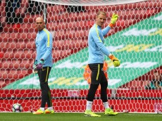 STOKE ON TRENT, ENGLAND - AUGUST 20: Joe Hart of Manchester City (R) warms up with team mate Willy Cabellero of Manchester City (L) during the Premier League match between Stoke City and Manchester City at Bet365 Stadium on August 20, 2016 in Stoke on Trent, England.  (Photo by Michael Steele/Getty Images)