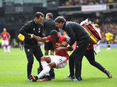 WATFORD, ENGLAND - SEPTEMBER 18: The Manchester United medical staf help Anthony Martial of Manchester United up after being injured  during the Premier League match between Watford and Manchester United at Vicarage Road on September 18, 2016 in Watford, England.  (Photo by Laurence Griffiths/Getty Images)