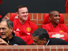 MANCHESTER, ENGLAND - SEPTEMBER 24: Wayne Rooney of Manchester United (L) shares a smile with Ashley Young of Manchester United (R) while sitting on the bench  during the Premier League match between Manchester United and Leicester City at Old Trafford on September 24, 2016 in Manchester, England.  (Photo by Clive Brunskill/Getty Images)