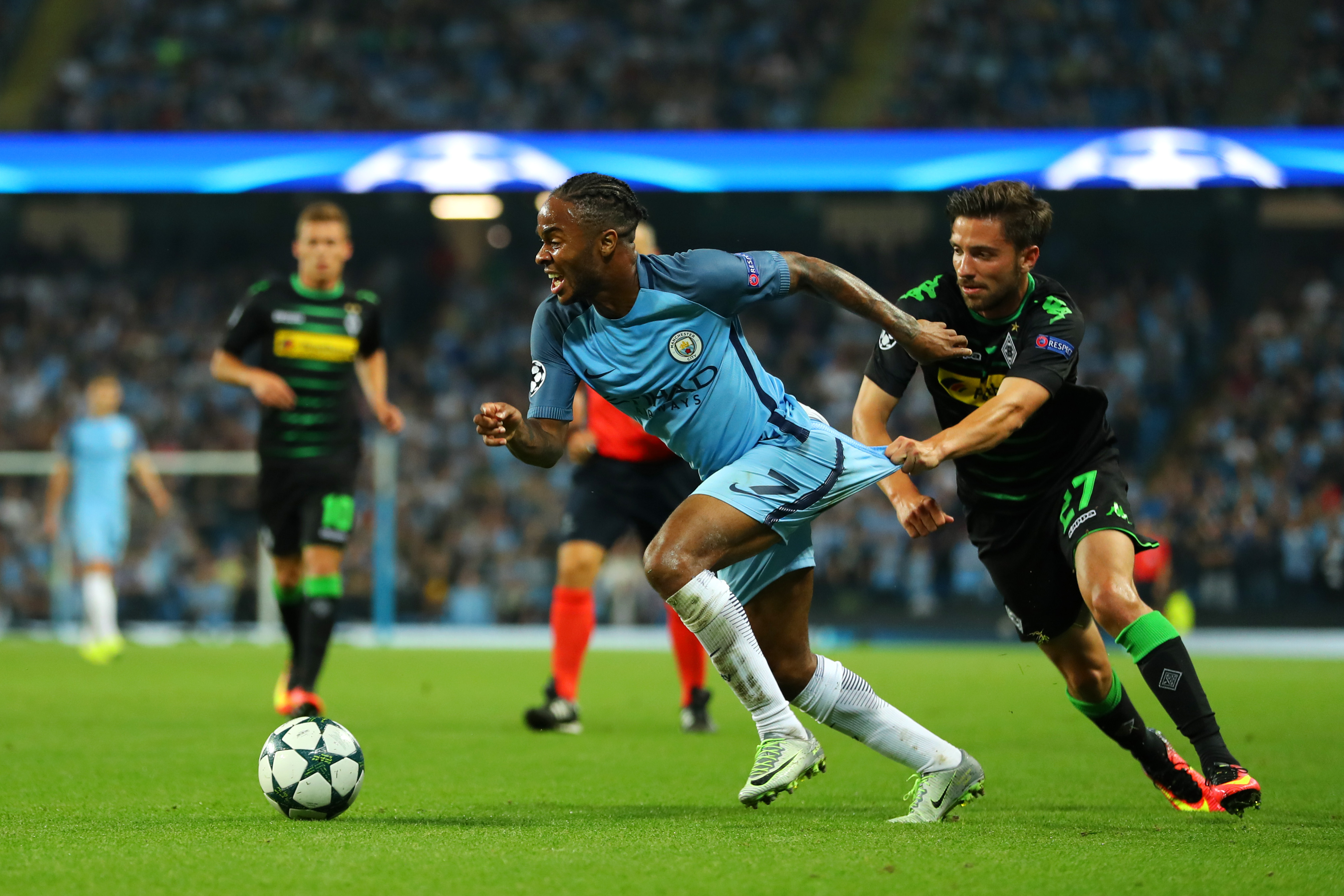 MANCHESTER, ENGLAND - SEPTEMBER 14: Raheem Sterling of Manchester City is pulled back by Julian Korb of Borussia Moenchengladbach during the UEFA Champions League match between Manchester City FC and VfL Borussia Moenchengladbach at Etihad Stadium on September 14, 2016 in Manchester, England.  (Photo by Richard Heathcote/Getty Images)