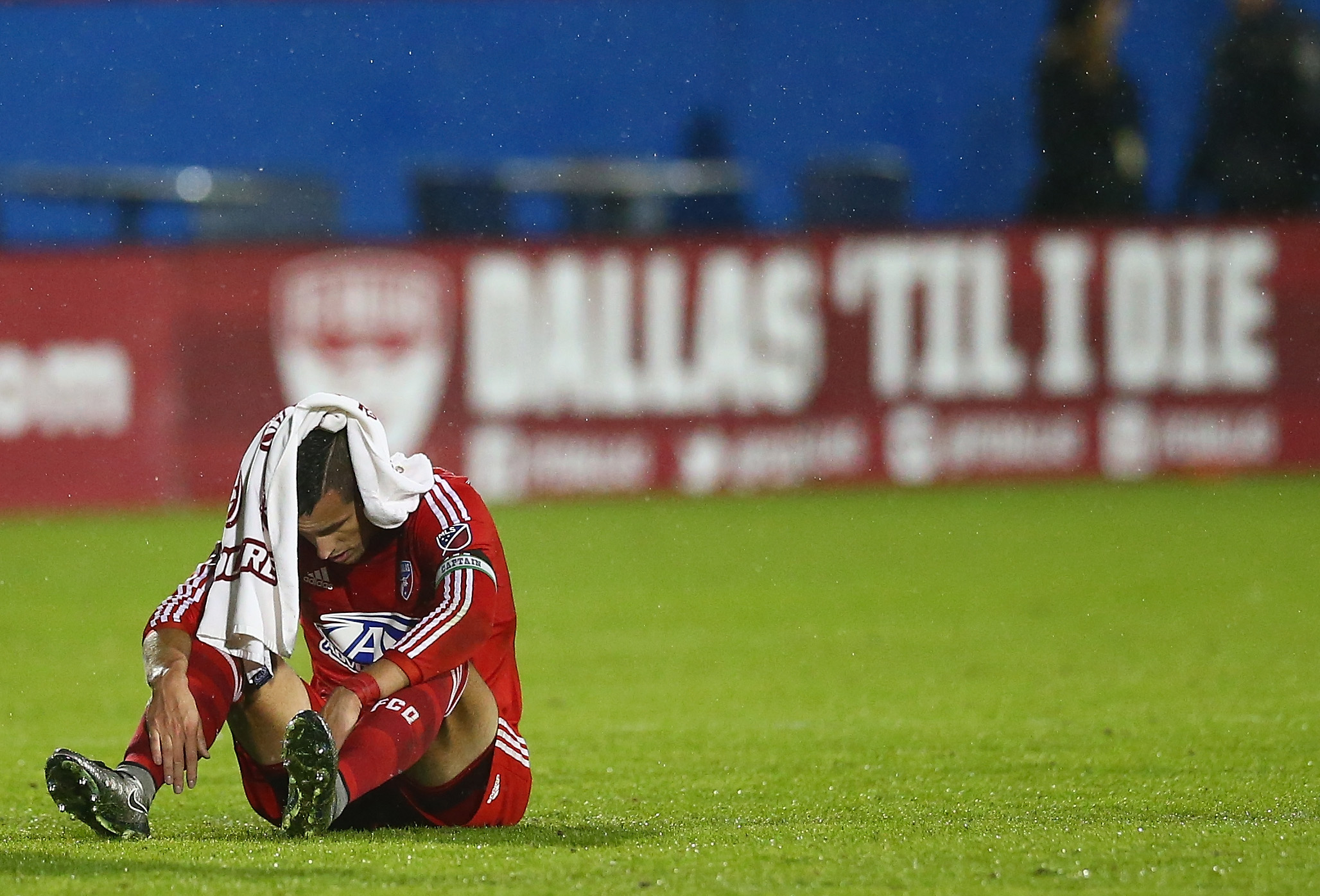 FRISCO, TX - NOVEMBER 29:  Matt Hedges #24 of FC Dallas sits on the field after losing to the Portland Timbers during the Western Conference Finals-Leg 2 of the MLS playoffs at Toyota Stadium on November 29, 2015 in Frisco, Texas.  (Photo by Ronald Martinez/Getty Images)