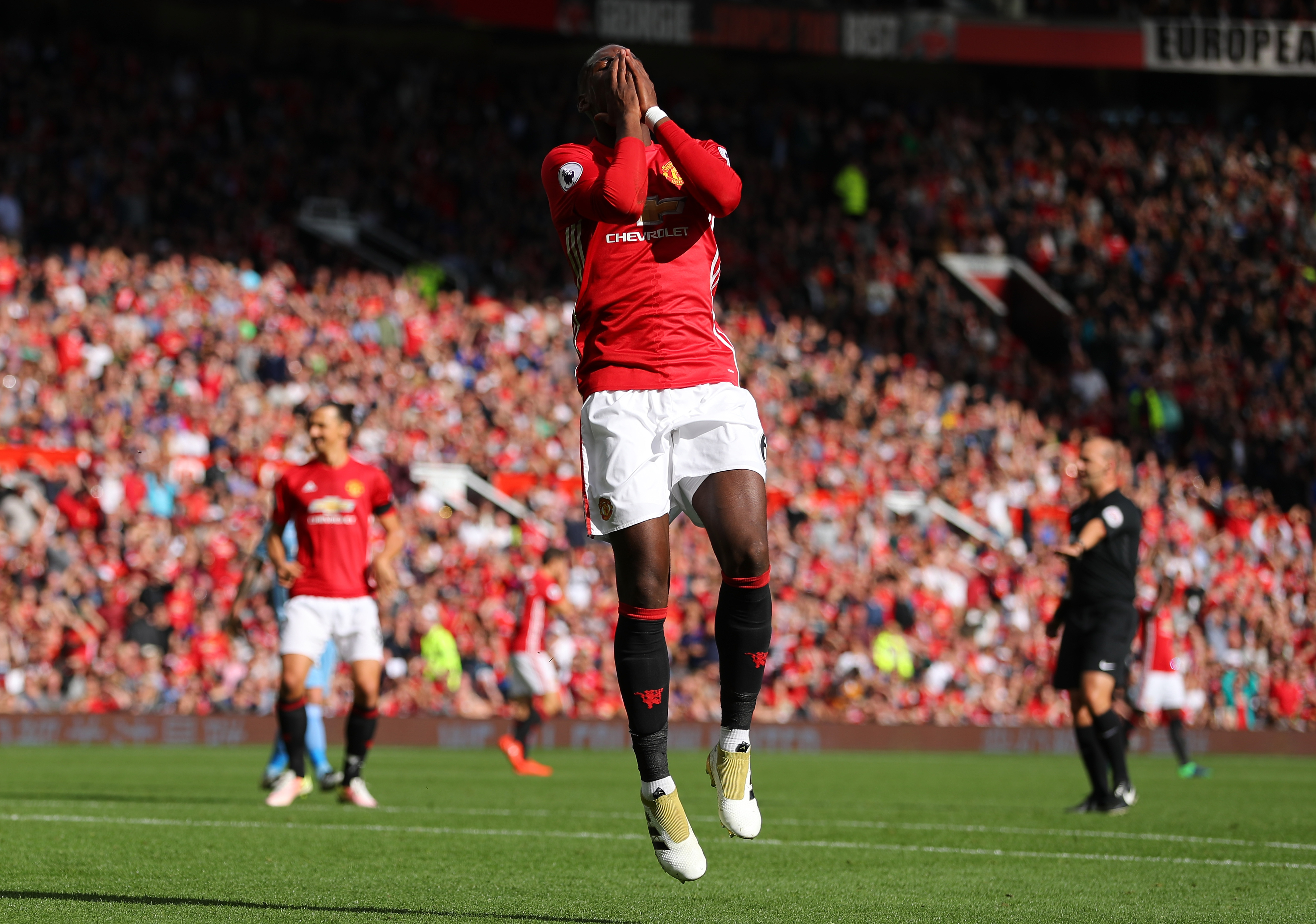 MANCHESTER, ENGLAND - OCTOBER 02:  Paul Pogba of Manchester United reacts to shooting wide of the goal during the Premier League match between Manchester United and Stoke City at Old Trafford on October 2, 2016 in Manchester, England.  (Photo by Richard Heathcote/Getty Images)