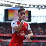 LONDON, ENGLAND - OCTOBER 15: Mesut Ozil of Arsenal celebrates scoring his sides third goal during the Premier League match between Arsenal and Swansea City at Emirates Stadium on October 15, 2016 in London, England.  (Photo by Mike Hewitt/Getty Images)