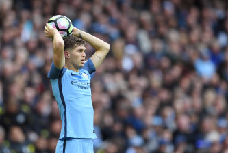 MANCHESTER, ENGLAND - OCTOBER 23: John Stones of Manchester City takes a throwin during the Premier League match between Manchester City and Southampton at Etihad Stadium on October 23, 2016 in Manchester, England.  (Photo by Laurence Griffiths/Getty Images)