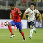 HOUSTON, TX - JUNE 11:  Johan Venegas #11 of Costa Rica brings the ball up the field as Stefan Medina #15 of Colombia pursues at NRG Stadium on June 11, 2016 in Houston, Texas.  (Photo by Bob Levey/Getty Images)