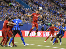 MONTREAL, QC - NOVEMBER 22:  Nick Hagglund #6 of the Toronto FC jumps to play the ball during leg one of the MLS Eastern Conference finals against the Montreal Impact at Olympic Stadium on November 22, 2016 in Montreal, Quebec, Canada.  (Photo by Minas Panagiotakis/Getty Images)